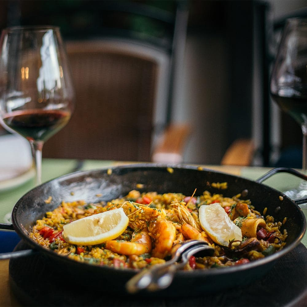 Scrumptious paella and red wine from La Española Olive Oil Instagram