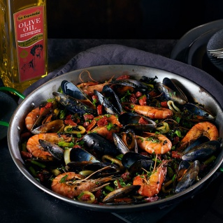 Black rice paella with seafood